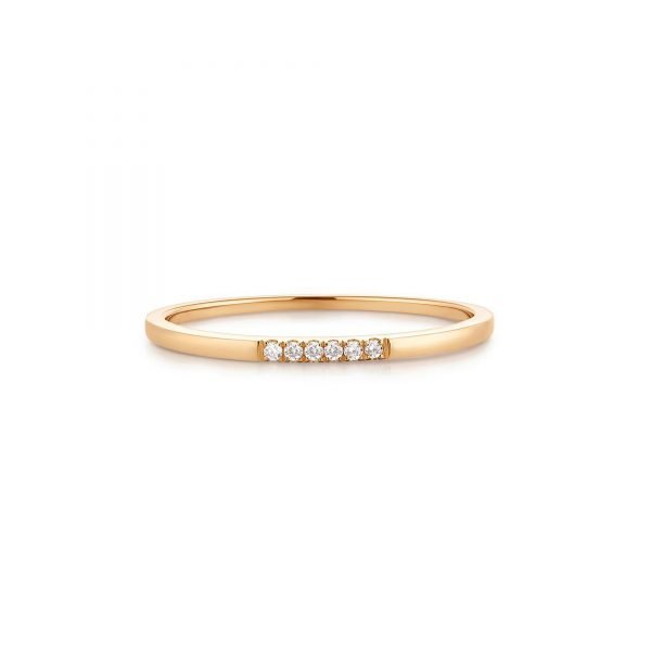 Diamond Band. Add some eye-catching sparkle to your finger or give this diamond band as a special gift. Six natural diamonds adorn this classic gold band for the perfect luxurious look.